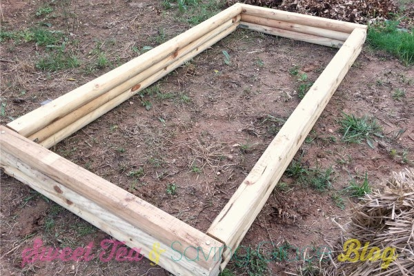 How to build a raised garden bed for under 40 sweet tea - What to put under raised garden beds ...