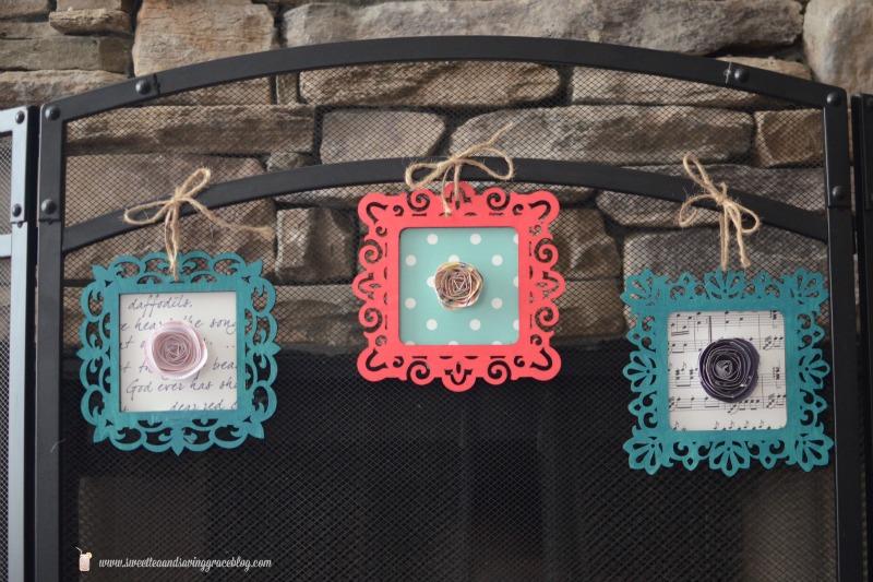 Framed images hanging on fireplace