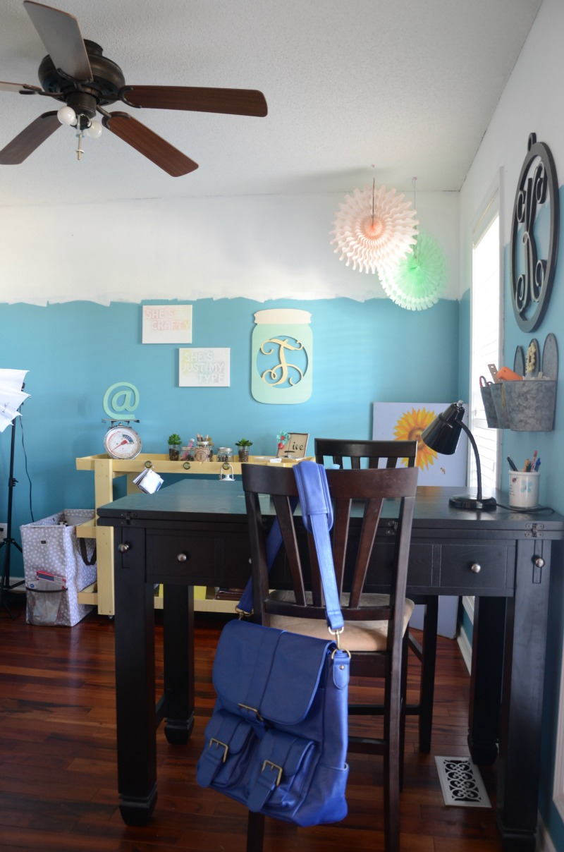 This bright, cheery, and colorful home office takes some design chances, but when everything comes together, it all makes sense! Great way to give a home office a facelift on a budget.