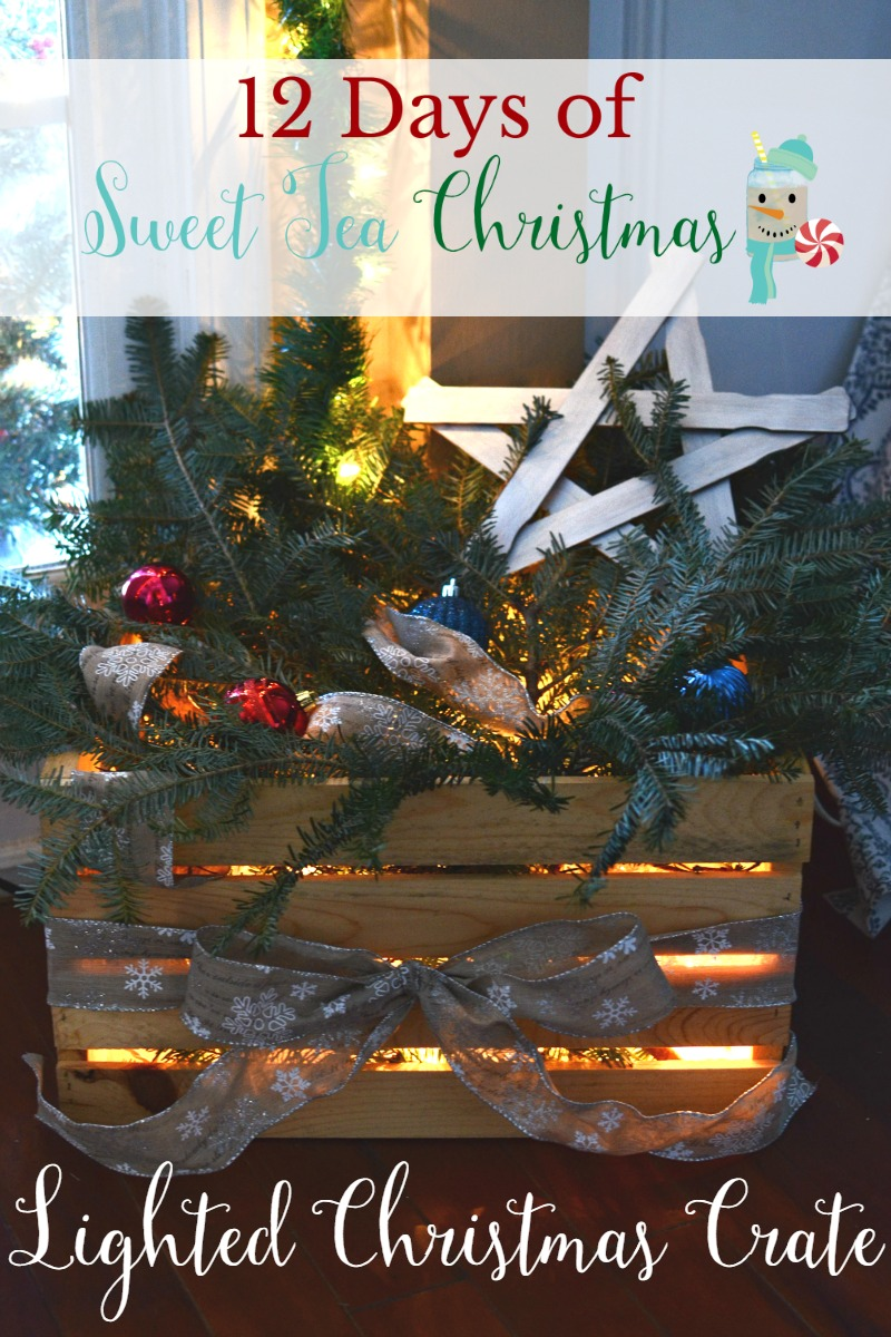 Hide ugly cords and add some festive flair to your decor! This simple Lighted Christmas Crate is easy to set up, and uses things you probably already have around your home! Part of 12 Days of Sweet Tea Christmas!