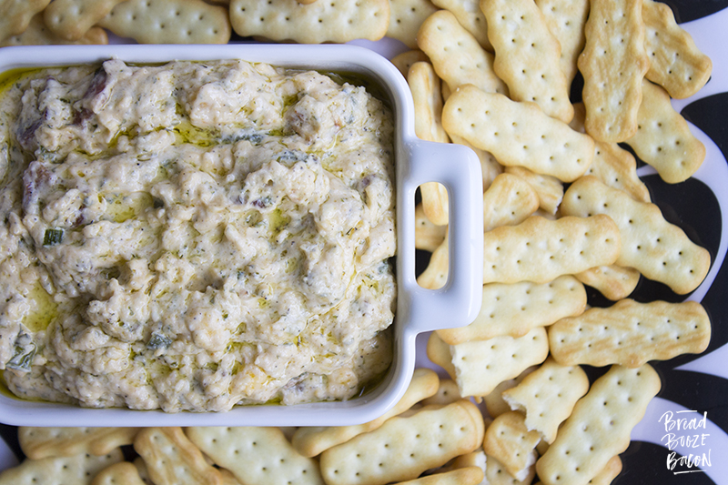 Slow Cooker Bacon Ranch Dip is my go to dip for game day. Super cheesy and studded with bacon, this easy to make dip is always a crowd pleaser!