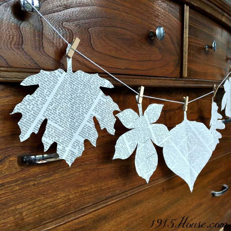 Repurpose an old book into a quick and easy fall leaf garland in only 20 minutes. This is a must-do for everyone who loves fast Fall projects - on a dime.