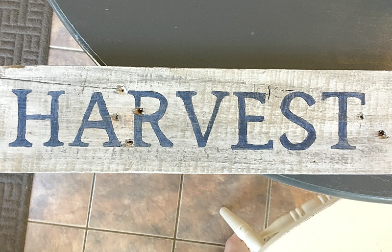 Create a DIY barnwood sign that is perfect for your home with layers of paint and an easy hand lettering technique. Check out the step by step barnwood sign tutorial.