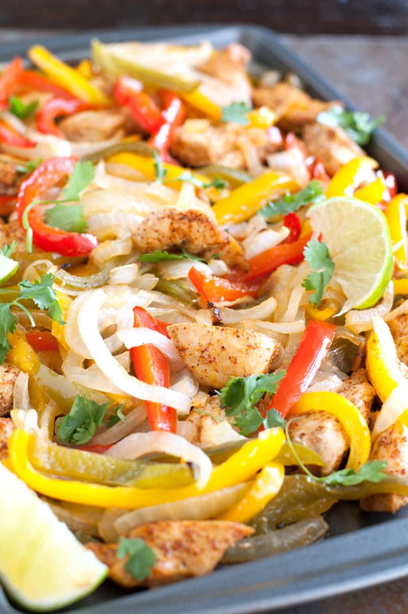 Chili lime chicken sheet pan fajitas, loaded with marinated chicken, peppers and onions, this is sure to be a family favorite!