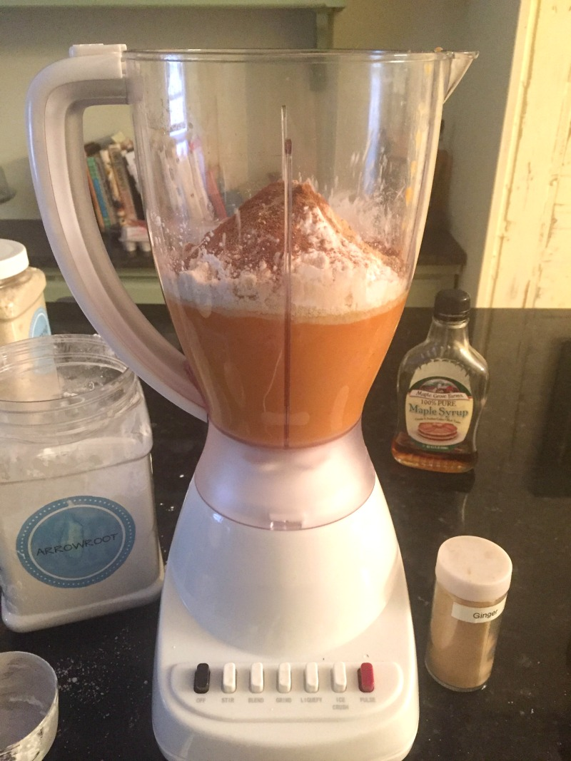 After blending all wet ingredients, add all dry ingredients for pumpkin chocolate chip muffins and blend again.
