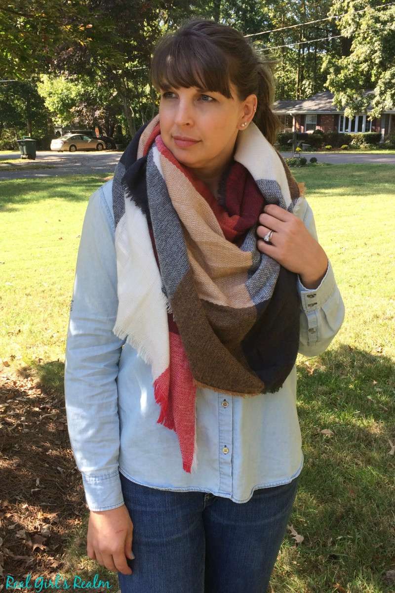 Winter's hottest accessory is the blanket scarf! It adds interest to any outfit. Here are 5 ways to style one!