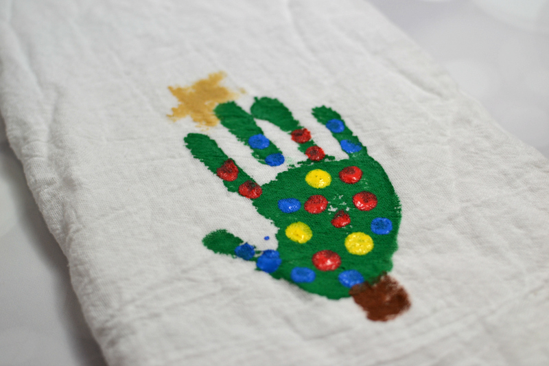 Of course you can't forget to put your tree trunk and star on your Christmas Tree Handprint.