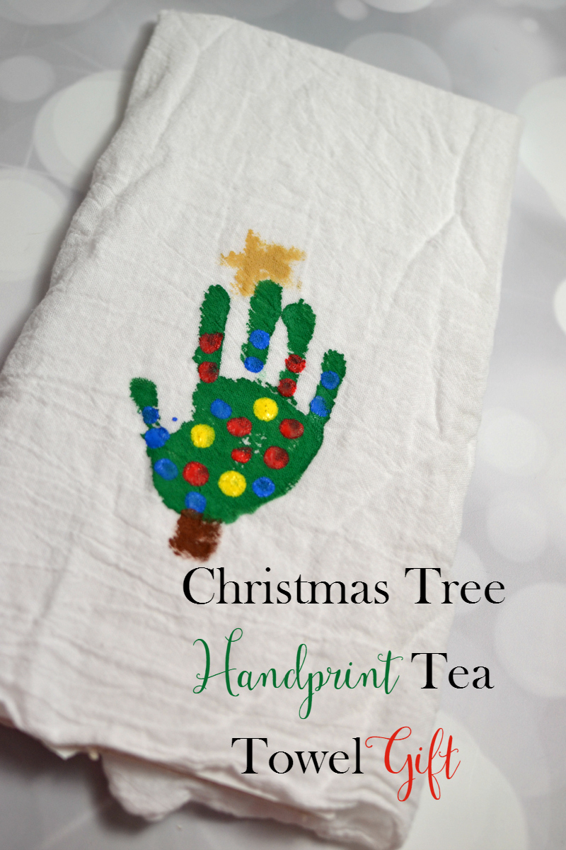 Make a sweet and easy Christmas Tree Handprint Tea Towel gift that is perfect for gifting to grandparents, aunts, and more!