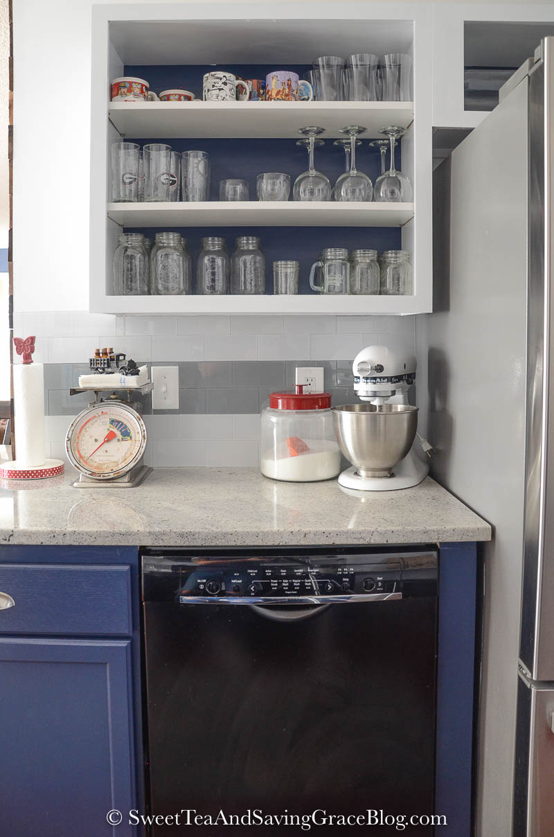 A dark, cramped kitchen gets a gorgeous rustic & contemporary kitchen makeover and the results are unbelievable! What a transformation! Gorgeous navy blue cabinets, granite, barnwood on the walls - so many details and it's all perfection!