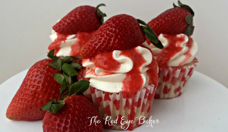 Strawberries & Cream Cupcakes | Fluffy vanilla cupcake, topped with light cream cheese buttercream and a fresh strawberry puree make these Strawberries & Cream Cupcakes a delightful treat any time of the year.