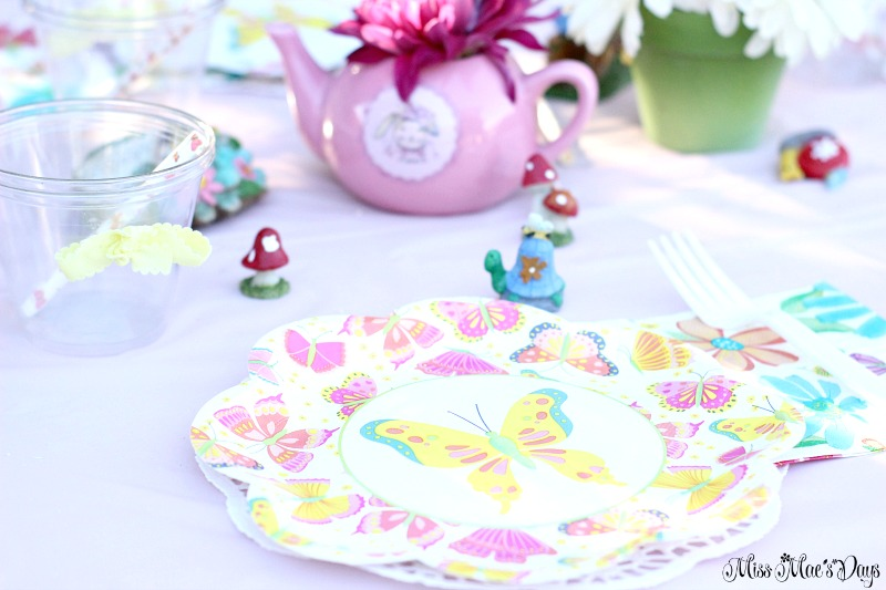 Dollar Store Garden Party Tablescape, butterfly plates and napkins with a doily