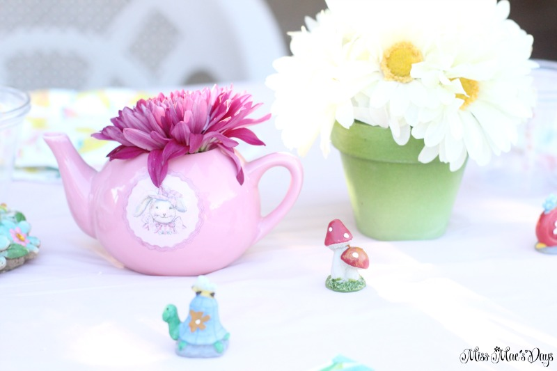 Dollar Store Garden Party Tablescape flowers and garden figurines