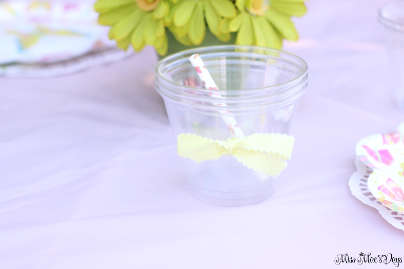 Dollar Store Garden Party Tablescape, plastic cup with yellow bow and paper straw